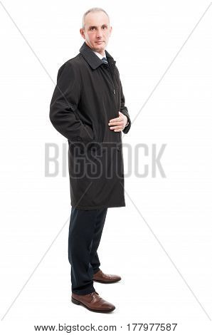 Side View Of Middle Age Elegant Man Posing Wearing Raincoat