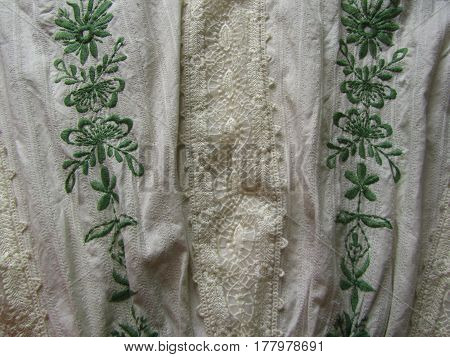 Linen fabric with embroidery and lace background