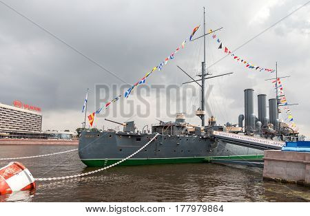 ST. PETERSBURG RUSSIA - JULY 29 2016: The legendary revolutionary cruiser Aurora at the place of eternal parking at Neva river in St. Petersburg Russia