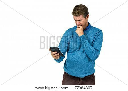Surprised man using calculator against white background