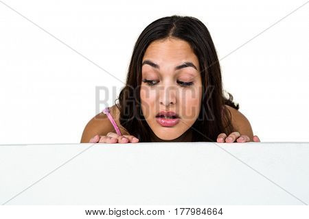 Close-up of woman peeking against white background