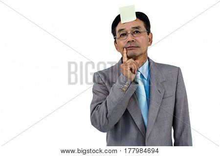 Businessman with blank note on forehead on white background