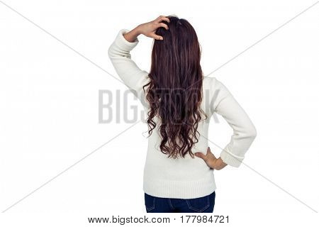 Rear view of brunette with hand on hair on white screen