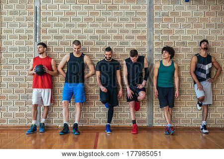Team of basketball players making a break on the court.