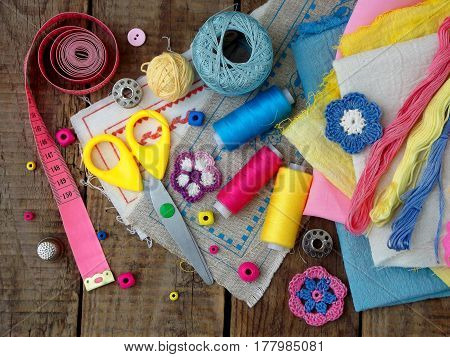 Pink, Yellow And Blue Accessories For Needlework On Wooden Background. Knitting, Embroidery, Sewing.