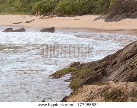 Beach and rocky coast, with strong waves, in summer day