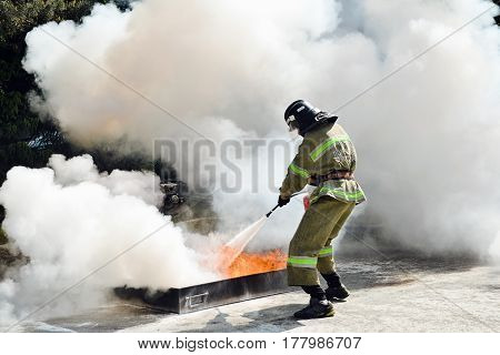 Firefighters fighting fire during training in outdoor