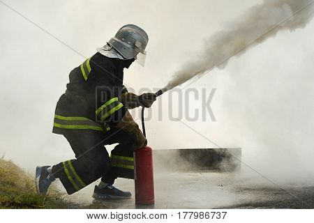 fighting fire during training, smoke in outdoor