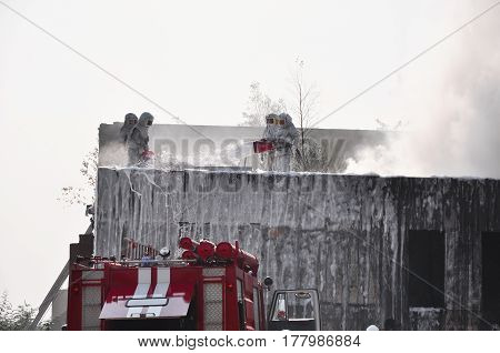 Firefighters on the roof of a house