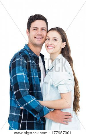 Couple standing head against head on white background