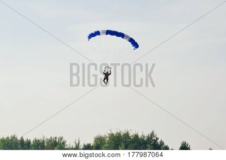 parachute sport on blue sky outdoor background