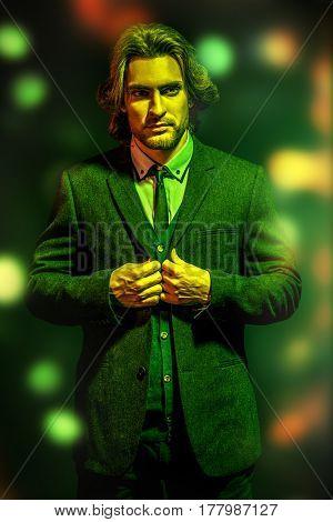 Portrait of a handsome fashion man wearing elegant classic suit. Male beauty, fashion. Studio shot.