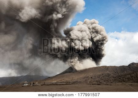 Grey smoke coming out of an active volcano filling the sky at the Tengger Semeru National Park in East Java Indonesia.