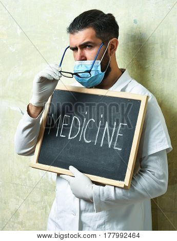 Bearded Brutal Caucasian Doctor Or Postgraduate Student Holding Board