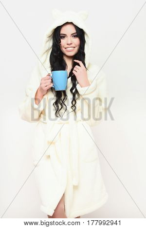 Smiling Sexy Girl Posing In Beige Velour Bathrobe With Cup