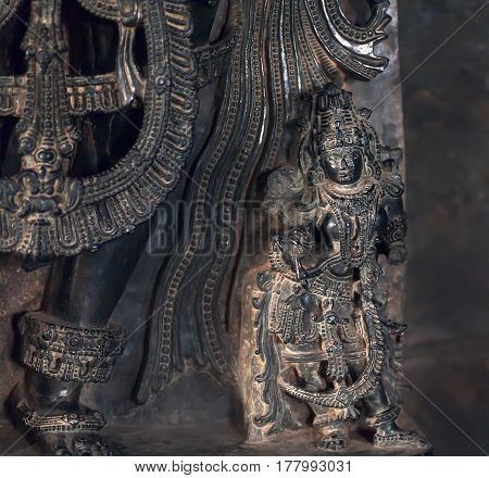 Selective focus on Indian god Parvati in dark, 12th century temple Hoysaleswara, India. Temple was built in 1150 by king of Hoysala Empire
