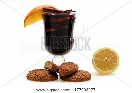 Glass Of Red Mulled Wine With Cookies And Lemon