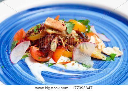 Chicken salad on blue porcelain plate