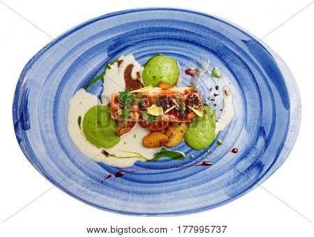 Chicken fillet on blue porcelain plate isolated over white background