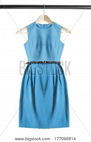 Elegant blue sleeveless dress on wooden clothes rack isolated over white