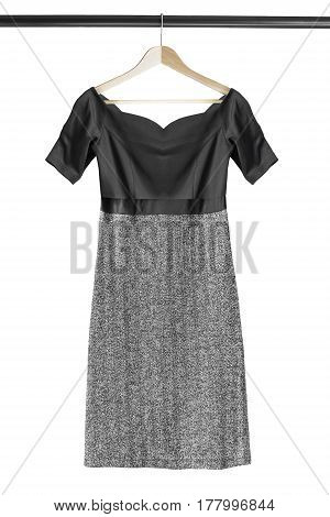 Elegant dress with tweed skirt on wooden clothes rack isolated over white