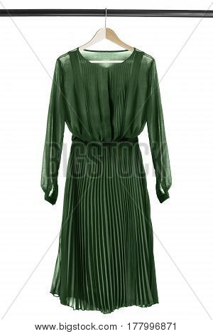 Green chiffon vintage dress on wooden clothes rack isolated over white