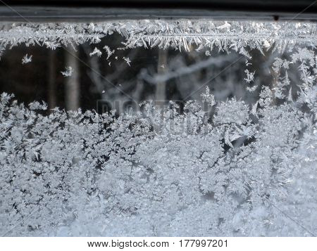 The windows are covered with frost after a cold night