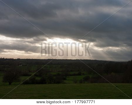 A glorious shot of the light penetrating the overcast sky and illuminating the vale of Dedham