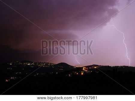 Night Storm With Bolts And Thunders Over The Hills Surrounding Florence