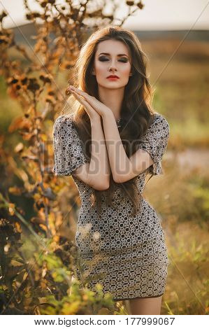 Beautiful and oung woman outdoor with fashionable clothing
