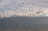 Rain Drops on Window after storm with sky blurred poster