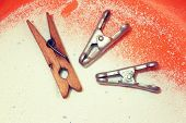 Clothespin,laundry detergent, bowl.Large Laundry.Photo toned.Household items in retro style close-up. poster