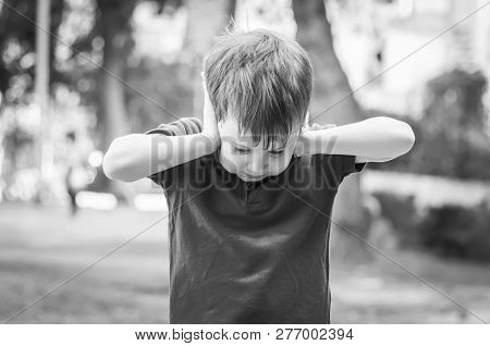 Cute Caucasian Child Closing Ears With Hands Out Of Stress And Despair. Autism, Autistic Child, Aspe