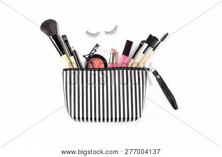 Make Up Bag With Various Cosmetics And Brushes Isolated On White Background, Top View, Beauty Concep