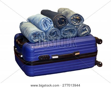 A Stack Of Blue Jeans In A Blue Suitcase, Isolated