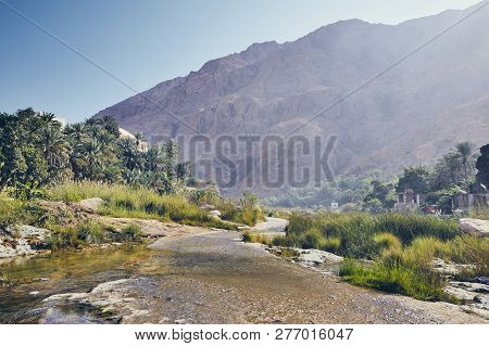 Landscape Of Oman. Road In The Middle Of Wadi Tiwi In Idyllic Day.