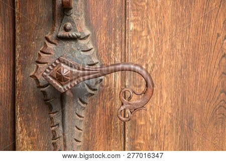 Door Handle Of An Old Historical Building Made Of Iron