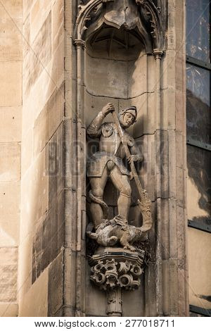 Stone Statue Of A Knight And Dragon On A Historical Old Building