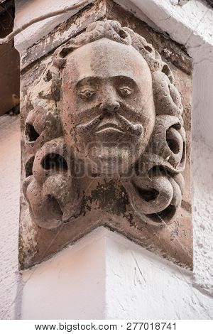 Stone Head On A Historical Old Building