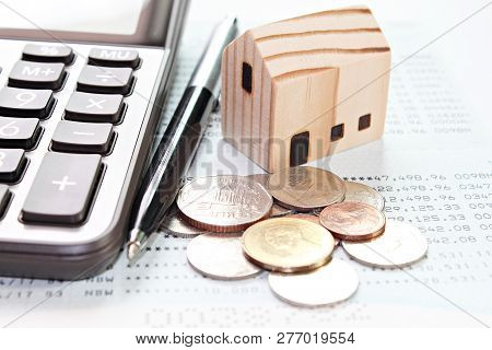 Business, Finance, Savings, Money Management, Property Loan Or Mortgage Concept : Wood House Model,