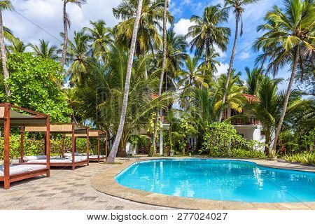 Tangalle, Sri Lanka - Nov 4, 2017: Swimming Pool And Beach Beds In A Tropical Hotel. Panorama Of The
