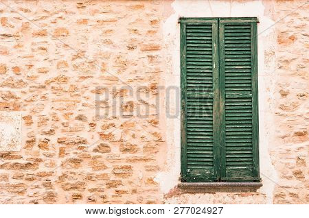 Old Mediterranean Window Shutters And Stone Wall Of Mediterranean House