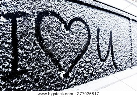 I Love You Heart Symbol On Frozen Window Of The Car. Shape Of Heart Drawn On Snow On Front Window Of