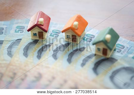 House Model On Banknotes, Saving Money For Real Estate Concept, House Model,  For Pay Loan,   Concep