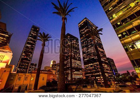 Commercial And Business Office Skyscrapers With Palms Tree In The Sky In Los Angeles. Urban Night Vi