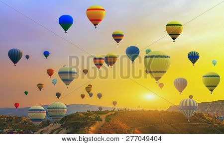 Spring Sunset Hot Air Balloons Landing In A Mountain, Discovery Fly Balloon Cappadocia Goreme Nation