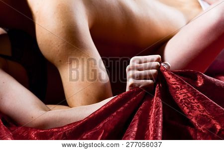 Female Orgasm. Sex And Pleasure Concept. Feeling Of Intense Sexual Pleasure. Hand Squeeze Bedclothes