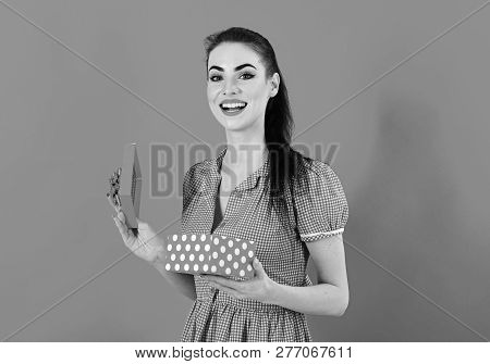 Girl Opening X-mass Present Isolated On Red Backgroun