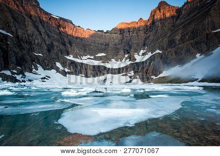 Sunrise At Iceberg Lake In Glacier National Park, Montana, Usa.
