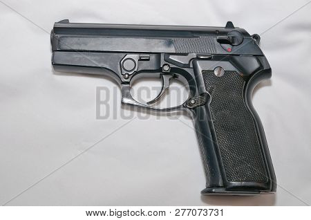 A Black Semiautomatic 40 Caliber Pistol On A White Background